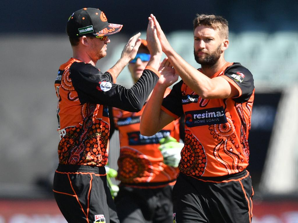 Ashton Turner and Andrew Tye from the Scorchers celebrate the dismissal of Alex Carey of the Adelaide Strikers during the Big Bash League (BBL) match between the Adelaide Strikers and the Perth Scorchers at Adelaide Oval in Adelaide, Saturday, February 9, 2019.(AAP Image/David Mariuz) NO ARCHIVING, EDITORIAL USE ONLY