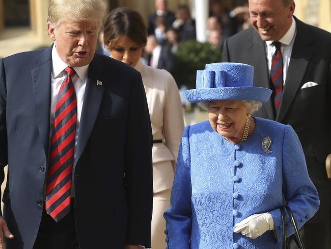 Donald Trump converses with the Queen after inspecting the Guard of Honour during his visit to Windsor Castle. Picture: Chris Jackson/Pool Photo via AP