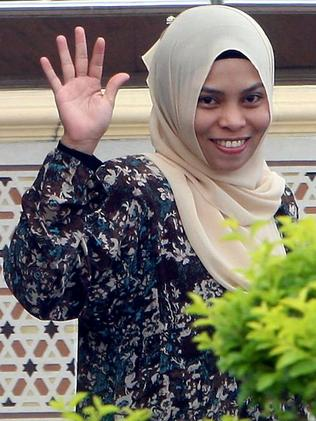 A relieved Kartika Sari Dewi Shukarno is released from prison after escaping a sentence for caning after the hospital worker was found guilty of drinking beer in a bar. Picture: AFP