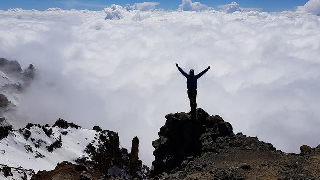 Climber Steve Plain on the crater rim at the top of Mount Kilimanjaro.