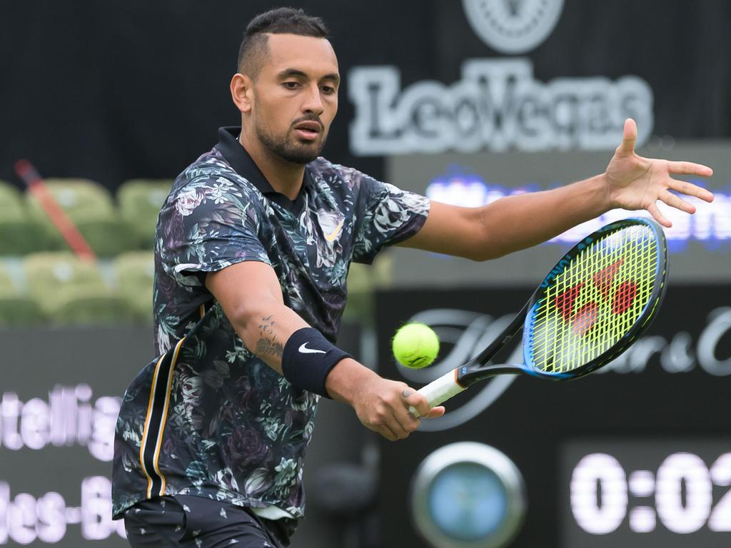 Australia's tennis player Nick Kyrgios returns the ball to Italy's Matteo Berrettini during their first round match at the ATP tennis tournament in Stuttgart on June 11, 2019. (Photo by Silas Stein / dpa / AFP) / Germany OUT