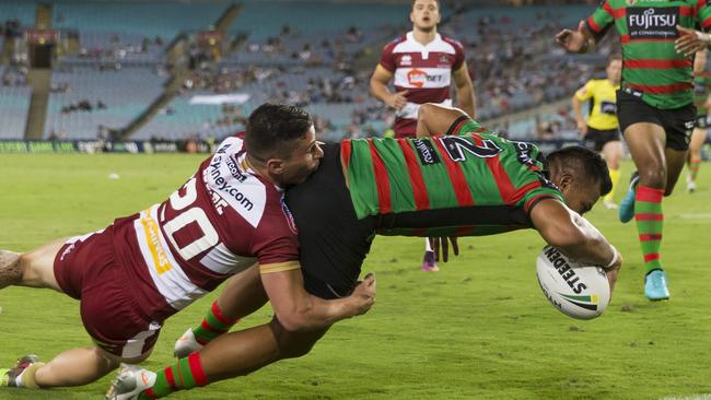 Richard Kennar of the Rabbitohs scores a try.