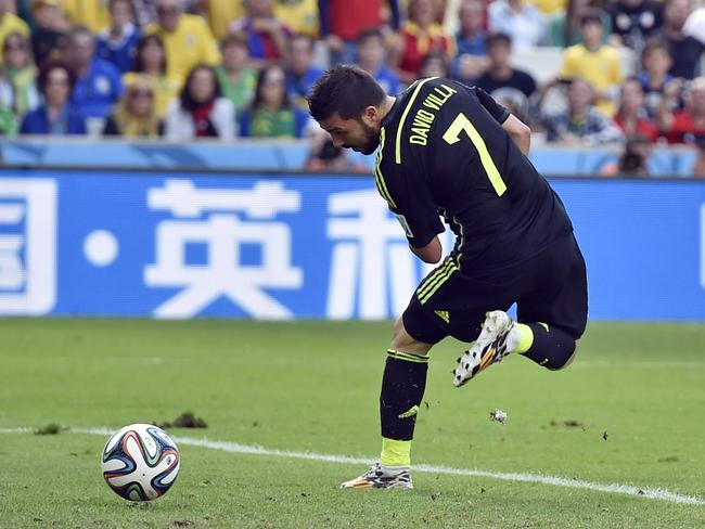 Spain's David Villa scores the opening goal during the group B World Cup match against Australia.