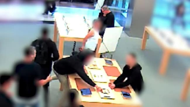 CCTV footage released by NSW Police show the three men flee when approached by store staff.