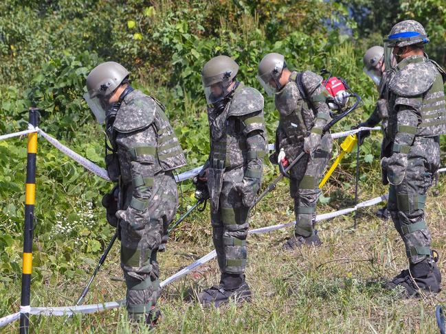 South Korean soldiers conduct landmine clearing operations inside of the Demilitarised Zone (DMZ) dividing the two Koreas. Picture: Song Kyong-Seok/AFP