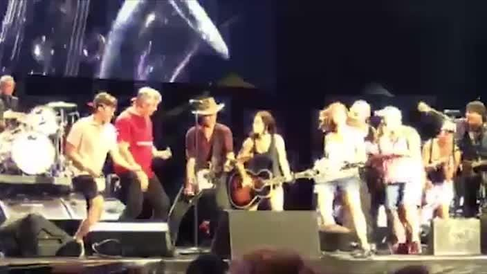 Bruce Springsteen is handed an Akubra hat by a fan at his Hunter Valley gig