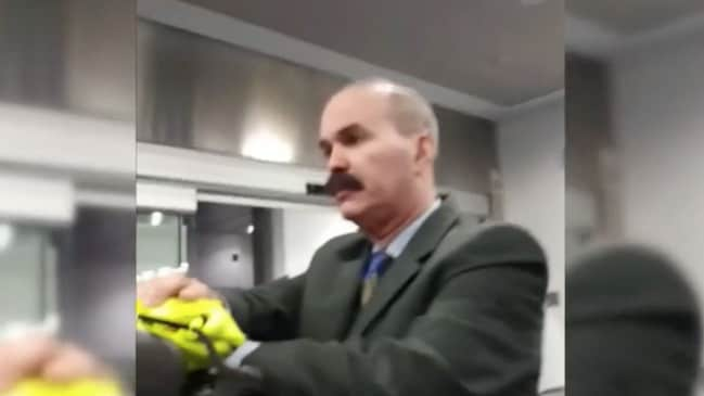 Yossi Adler filmed an American Airlines worker on his phone after the family were removed from the flight. Picture: WPLG