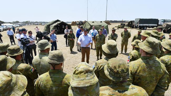 Prime Minister Scott Morrison visits the Defence Staging Ground at Kingscote Aiport on Kangaroo Island. Picture: David Mariuz/AAP