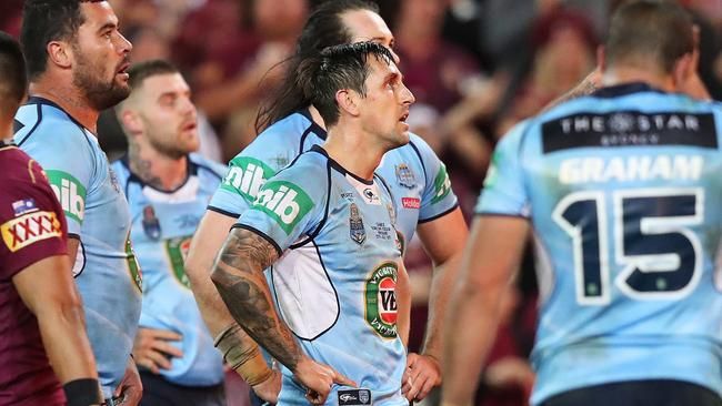 NSW's Mitchell Pearce looks on after a try by QLD's Jarrod Wallace during Game 3 of the State of Origin series between the NSW Blues and QLD Maroons at Suncorp Stadium, Brisbane. Picture: Brett Costello