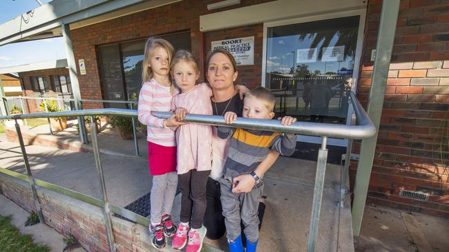 Sharlene Stringer with children Hayley, Becky and Tyler outside the Boort's medical clinic which will close from 1 November — leaving the town without doctors. Picture: Rob Leeson.