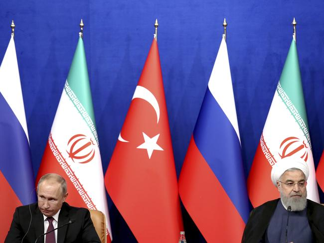 Russian President Vladimir Putin and Iran's Hassan Rouhani, at the talks which rejected a truce for Idlib. Picture: Ebrahim Noroozi.
