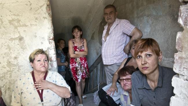 Living in fear ... locals caught up in the bombing of Donetsk. Picture: Ella Pellegrini