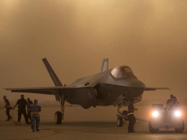 An Australian F-35A aircraft is towed to cover during a sudden dust storm at Luke Air Force Base, Arizona. Picture: Defence