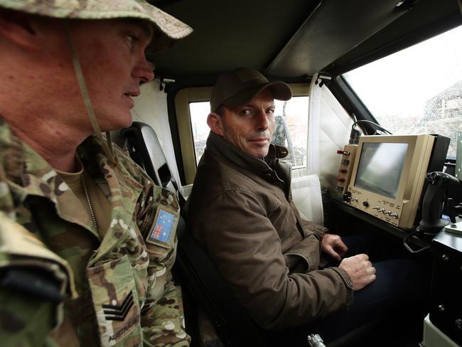 Tony Abbott visit to Australian troops in Tarin Kot, Afghanistan. SGT Scott Hannan shows Tony Abbott inside the PMV Bushmaster. Pic Mark Calleja