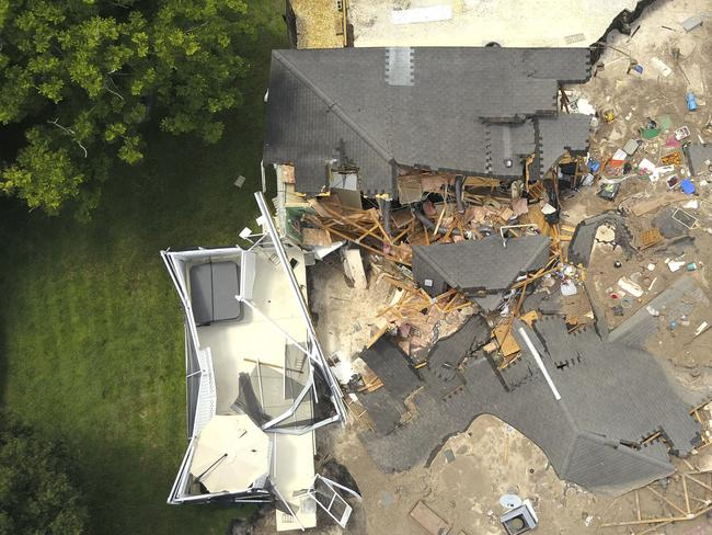 The sinkhole has sparked local evacuations in the area. Picture: Luis Santana/Tampa Bay Times via AP