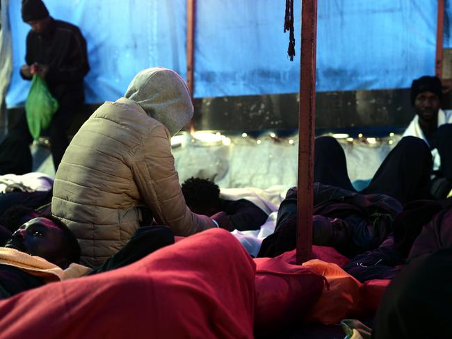 Life on-board the ship was tough for the hundreds of migrants.