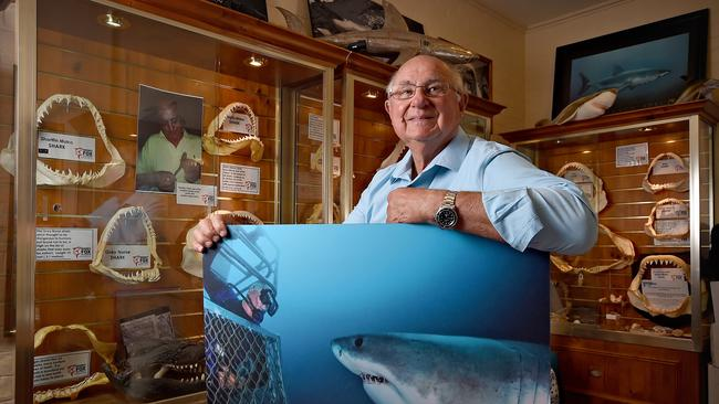 Rodney Fox at home with his shark artifact collection. Picture: Naomi Jellicoe