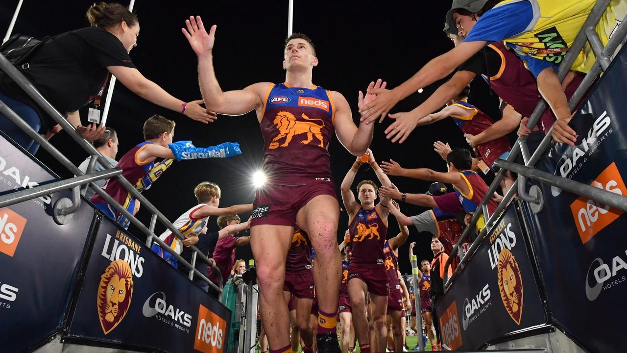Dayne Zorko of the Lions celebrates with fans after beating the West Coast Eagles.