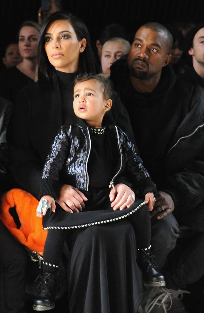 Kim Kardashian and Kanye West sit front row with then one-year-old North at New York fashion week in 2015.