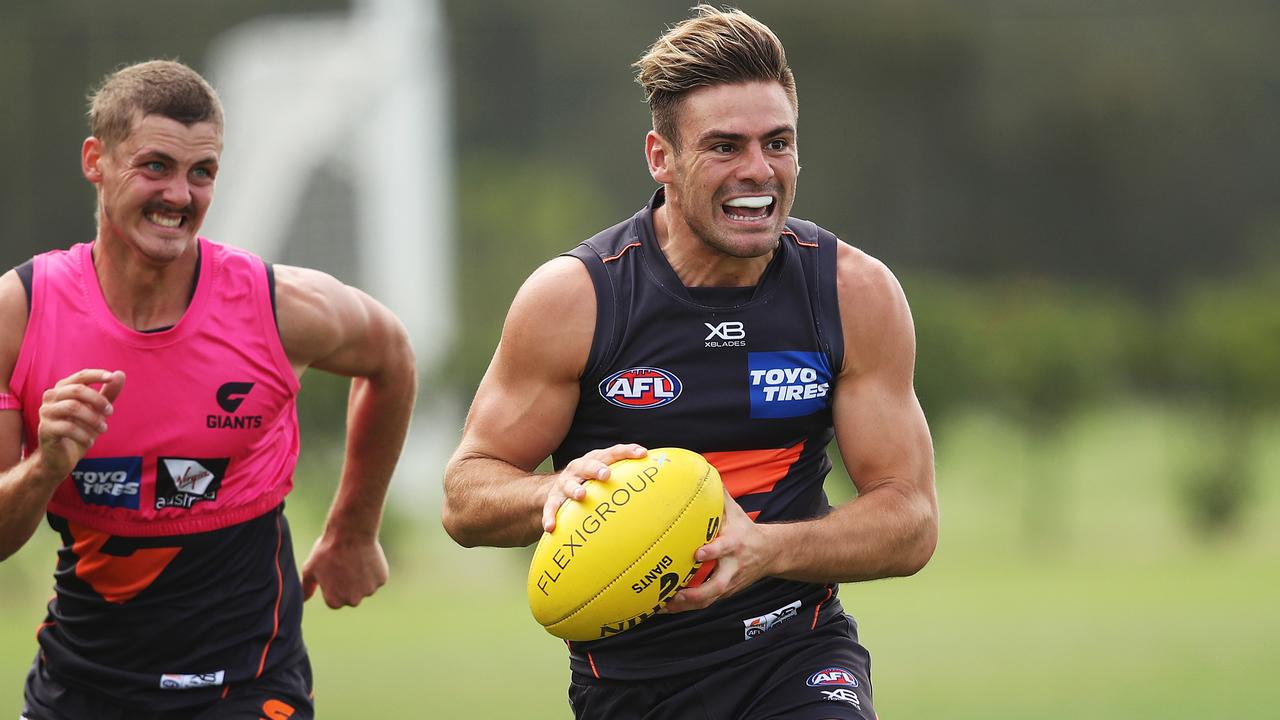 Stephen Coniglio chased by Harry Perryman. Picture: Phil Hillyard