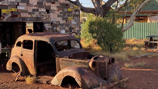 The town never recovered after the mining boom, and is filled with rusting cars and derelict cottages.