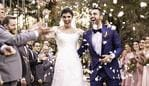Confetti throwing on happy newlywed couple