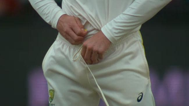 Bancroft shoving the offending piece of tape down his trousers.