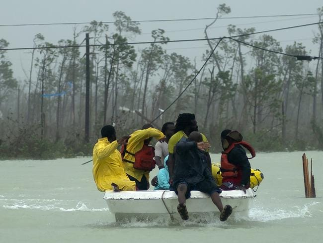 Volunteers rescue a family from the rising waters. Picture: Ramon Espinosa/AP Photo