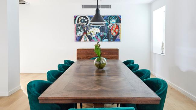 The custom-made Christian Cole table is stunning with the velvet, emerald green chairs. Source: The Block