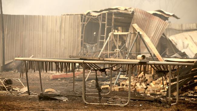 A family's backyard and children's trampoline and swing set destroyed in the town of Tingha. Picture: Nathan Edwards