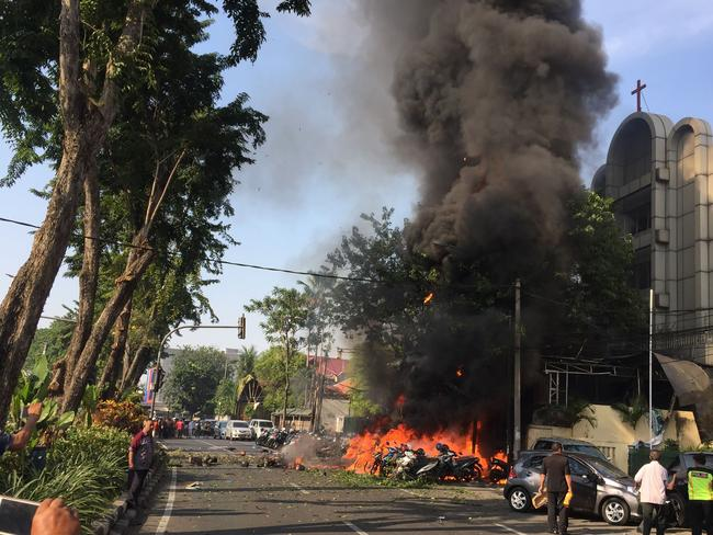 Police at the site of a blast outside the Gereja Pantekosta Pusat Surabaya (Surabaya Centre Pentecostal Church) in Surabaya. A series of blasts, including at least one suicide bombing, struck churches in Indonesia. Picture: AFP