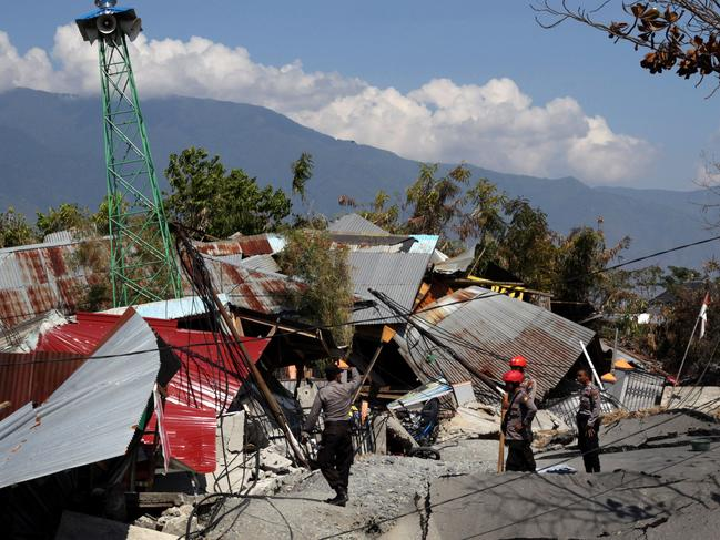 An Indonesian rescue team look for survivors in a collapsed home in Palu. Picture: AFP