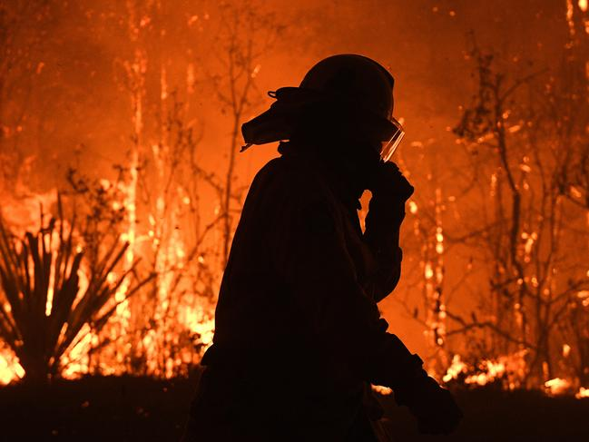 NSW Rural Fire Service crews protect properties on Waratah Road and Kelyknack Road as the Three Mile fire approaches Mangrove Mountain north of Sydney. Picture: AAP Image/Dan Himbrechts