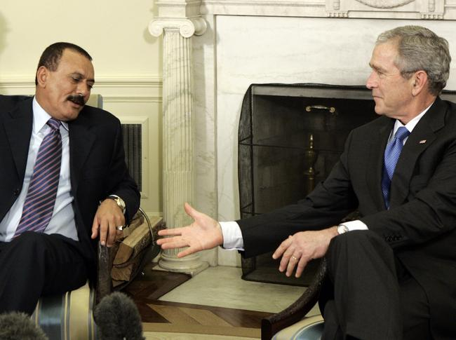 Ali Abdullah Saleh is pictured in 2004 in the Oval Office with George W Bush. Picture: AP/Charles Dharapak