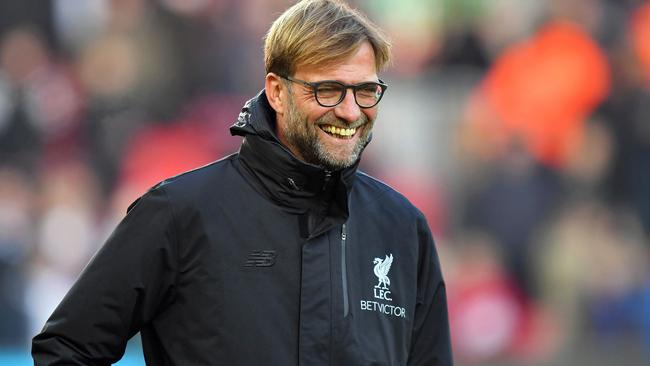 Liverpool manager Jurgen Klopp smiles before the English Premier League soccer match against Sunderland.