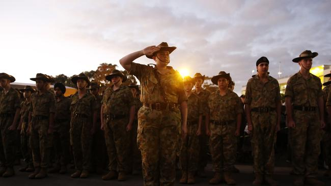 The sun begins to rise over the service at Blacktown RSL Club. Picture: David Swift