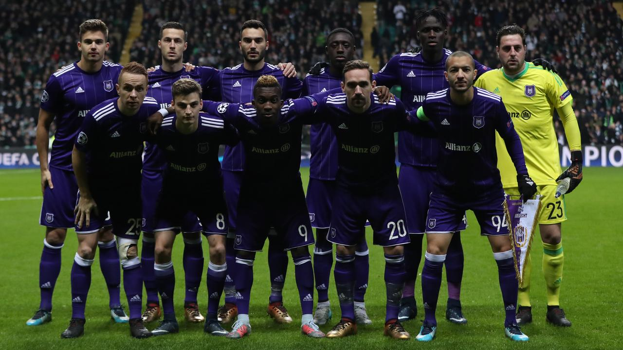 303fcfafe80 Anderlecht players line up before the UEFA Champions League match against  Celtic.