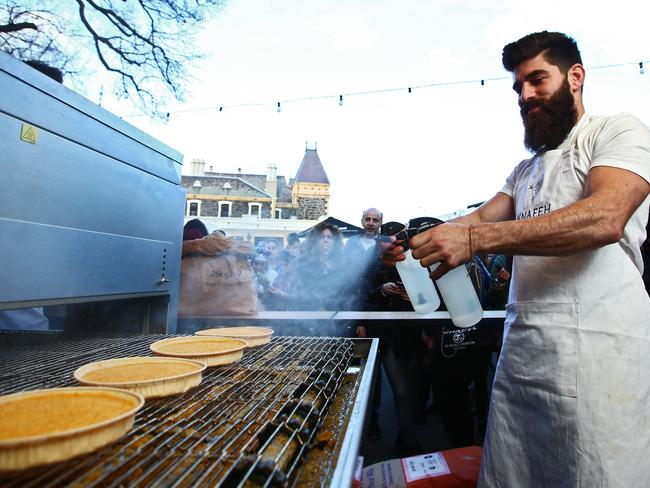 Joey El-Issa works the ovens.