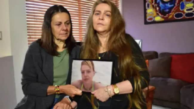 Kym Taylor's mother, Courtney Hill-Aaron, right, and her aunt Leanne Taylor, holding a picture of Kym Taylor, 37, whose body was found in bushland near Perth on Sunday morning. Source: Supplied