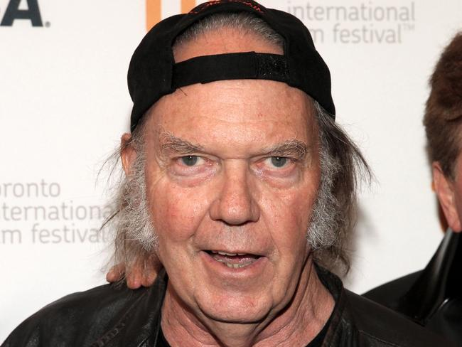 Very happy ... Singer Neil Young told John Mellencamp that he is not bothered by his divorce from wife Pegi after 36 years of marriage. Picture: Jonathan Leibson/Getty Images.