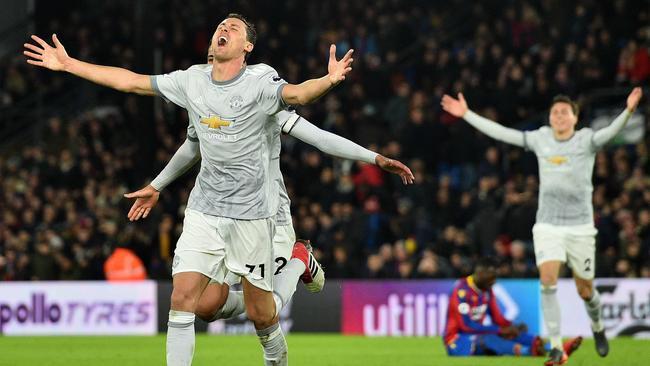 Manchester United's Serbian midfielder Nemanja Matic (C) celebrates