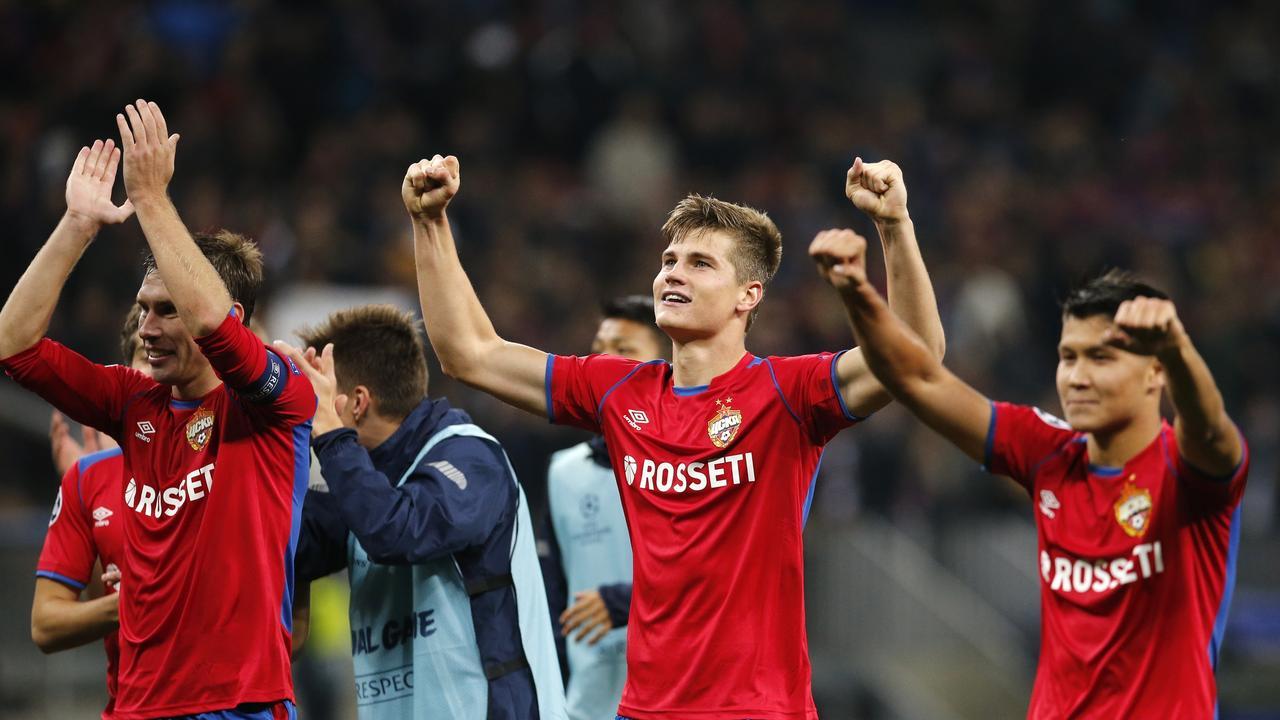 Boilover! CSKA defender Kirill Nababkin, Jaka Bijol, Ilzat Akhmetov celebrate their victory over Real Madrid.