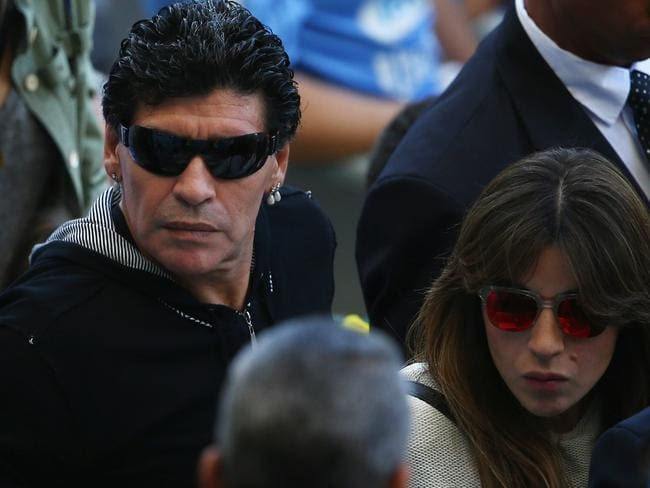 Diego Maradona and his daughter Giannina leavethe Argentina and Iran game early.