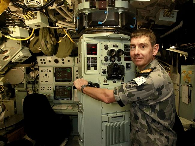 Cramped conditions ... A crew member on board HMAS Waller during a press visit last year.