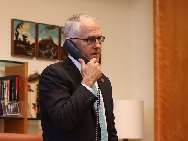 Malcolm Turnbull speaking to US President-elect Donald Trump ... on his private mobile line. Picture: Prime Minister's Office