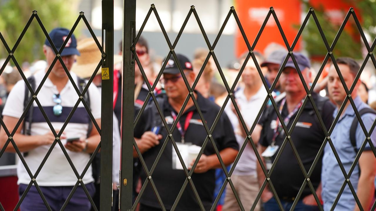 Spectators queue at the gate to gain entry, but to no avail.