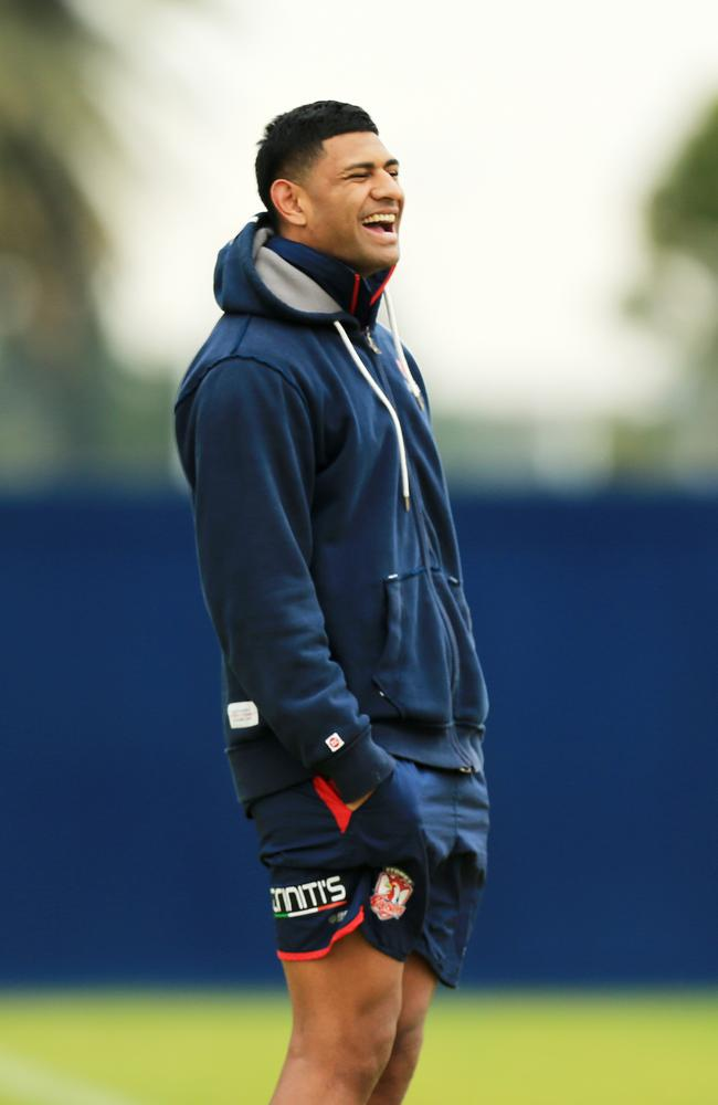 Daniel Tupou watches Roosters training from the sideline.