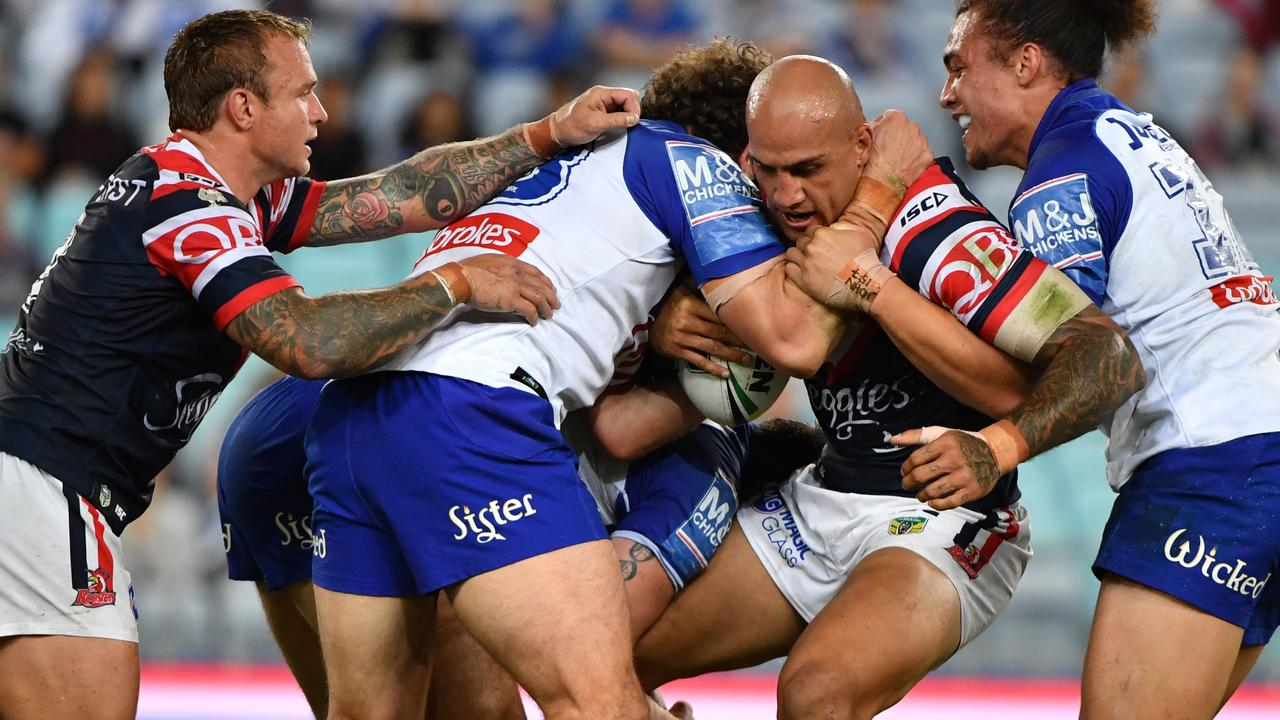 Roosters winger Blake Ferguson is tackled.