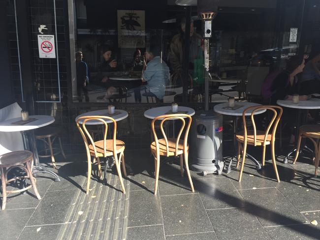 The empty seats outside the gourmet cafe next door to the pop-up.