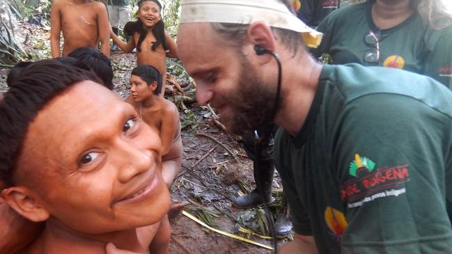 A man from the Korubo tribe smiles as a Funai worker checks his heart rate. Picture: Funai